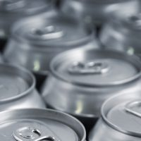 Lots of soda/beer cans in rows. Focus on closest can.Other drink can images: